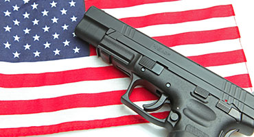 Pistol on American Flag - Red Ryder Armory